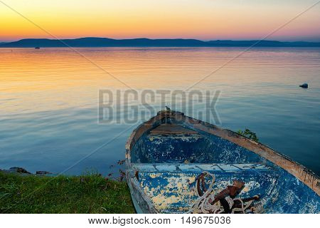 Lake Balaton in Hungary after sunset with a boat in the front