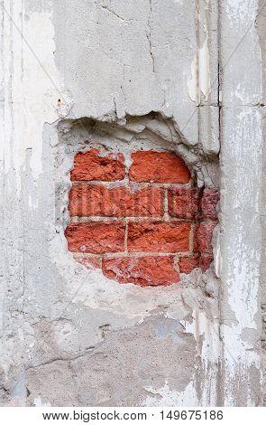 Old broken wall with visible bricks texture.