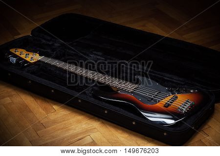 Bass Guitar In Padded Suitcase