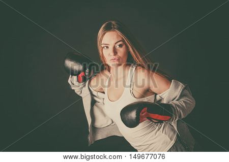 Exercising prepare for fight. Sportsmanship and strong body. Energetic woman wear sportswear with exposed shoulders boxing with opponent. Sport and fitness healthy lifestyle.