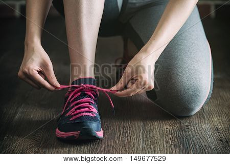 Knee Down With Tie Sneakers Shoestring Before Fitness Exercise