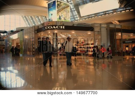 LOS ANGELES, UNITED STATES - DECEMBER 28 2015: The transit area of the airport LAX with travelers and illuminated shops and stores on December 28, 2015 in Los Angeles.
