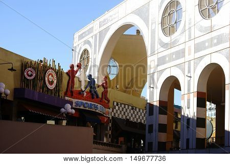 SAN DIEGO, UNITED STATES - DECEMBER 25 2015: Modern architecture of the Westfield Horton Plaza shopping mall with a sports shop on December 25, 2015 in San Diego.
