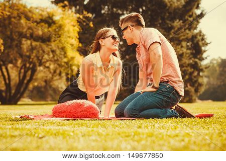 Love romance valentines relationship dating concept. Cheerful affectionate couple on picnic. Young lady and her man spend time together in park.