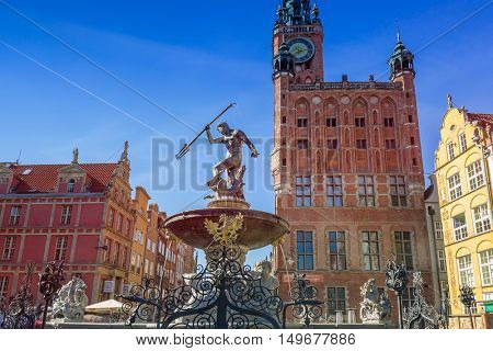 GDANSK, POLAND - SEPTEMBER 8, 2016: Fountain of the Neptune in old town of Gdansk, Poland. The bronze statue of Neptune made in 16th century is one the most recognizable symbols of Gdansk.