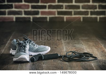 Sports Equipment Sneakers Rope Skipping For Fitness On Wooden Floor