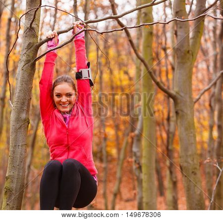 Young Sporty Girl Doing Exercises In Forest.
