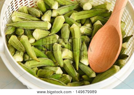 Fresh okra vegetable ready for cooking, closeup.