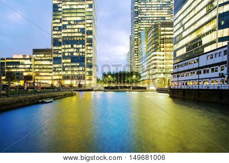 Canary Wharf offices with lights on in the evening