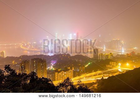 CHONGQING CHINA - DECEMBER 31: View form Yikeshu mountain in Chongqing which is a famous landmark in the distance you can see Chongqing's financial district and other buildings on December 31st 2014 in Chongqing