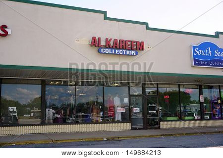 BOLINGBROOK, ILLINOIS / UNITED STATES - SEPTEMBER 17, 2016: Al Kareem Collection offers a variety of Pakistani and Indian-style clothes, including hijabs, men's clothes, jewelry, and women's dresses.