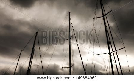 Mast on a background of dark sky. Black and white version with effects