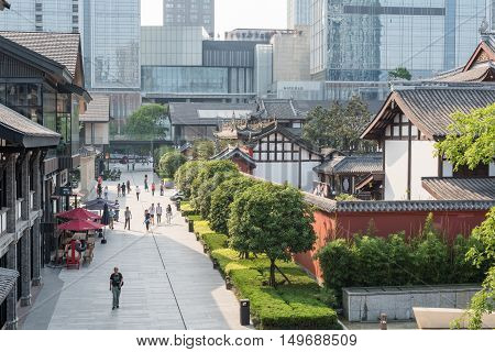 Chengdu Sichuan province China - May 10 2016: People walking in Taikooli commercial area.