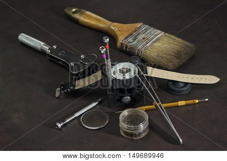 watch repair and watchmaker tools on table - can use to display or montage on products