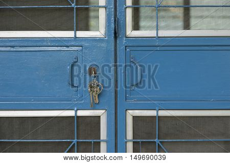 old steel blue door are locked and key on it - can use to display or montage on products