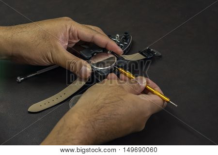 watchmaker try to open the watch with tools - can use to display or montage on product