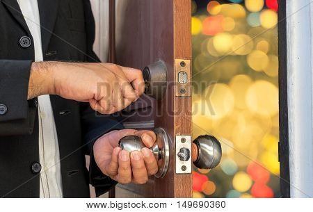 businessman open the door to night life bokeh - can use to display or montage on product