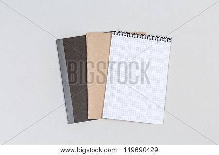 Top view three business books for background