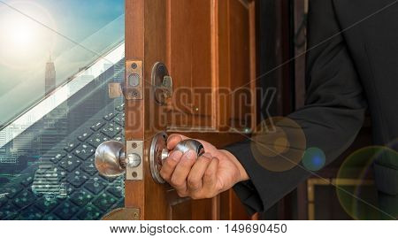businessman open door to abstract development city - can use to display or montage on product