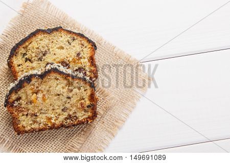 Fresh Baked Fruitcake On White Boards, Copy Space For Text