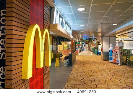 SINGAPORE - CIRCA SEPTEMBER, 2016: McDonald's in Singapore Changi Airport. McDonald's is the world's largest chain of hamburger fast food restaurants.