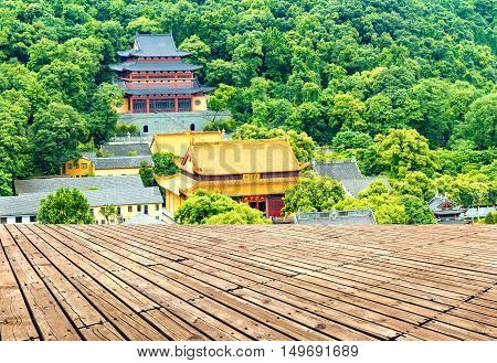 Surrounded by green trees in Hangzhou, Zhejiang, China, ancient temples buildings.