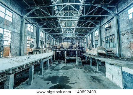 The abandoned factory floor was deserted and deserted
