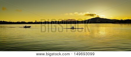 A rower training in the cold morning sunrise.