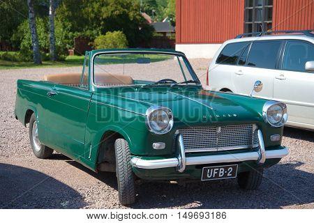 LOVIISA, FINLAND - AUGUST 20, 2016: Vintage car Triumph Herald 1200 Convertible on the streets of the city of Loviisa. Tourist landmark