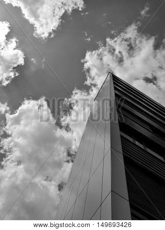Low angle view on building and clouds in black and white