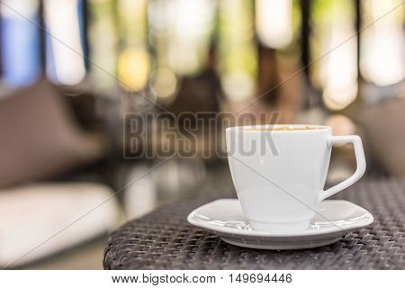 Coffee cup on table mocca soft focus