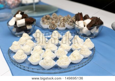 Small sweets on festive table in restaurant