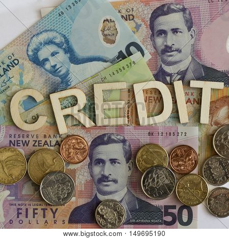 Credit signage with New Zealand notes and coins.