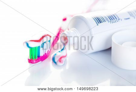 toothbrush with toothpaste close-up on white background