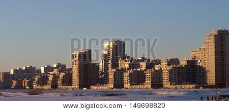 cityscape modern skyscapers in golden winter sunset