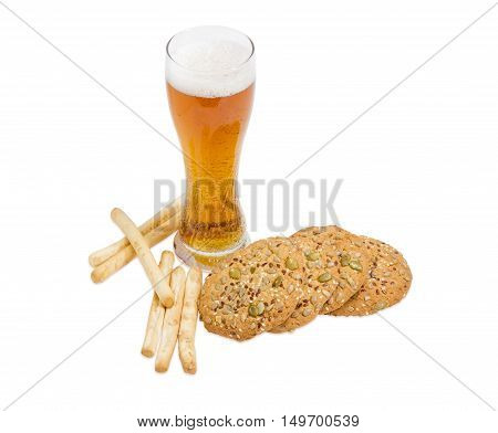 Beer glass with lager beer salted breadsticks and savory biscuits sprinkled with sesame seeds flax seeds pumpkin seeds and sunflower on a light background