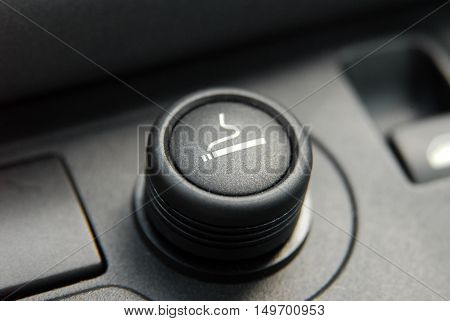 cigarette lighter on the dashboard of a passenger car