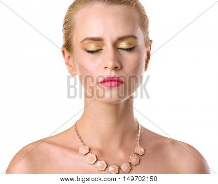 Portrait of young woman with beautiful necklace on white background