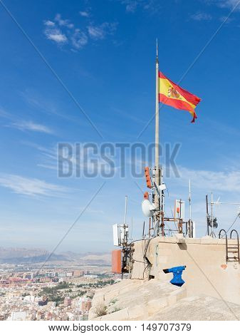 Alicante - 4 October 2015: A view of the city from the top of the ancient fortress of Santa Barbara and the Spanish flag 4 October 2015 El Campello Costa Blanca Spain