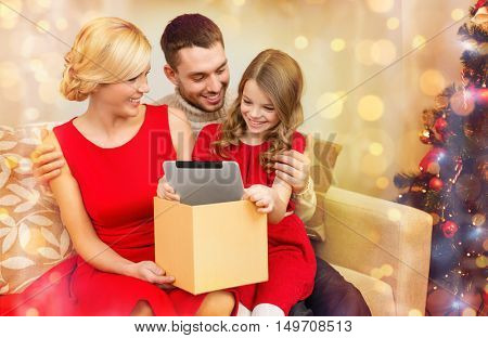 family, christmas, x-mas, winter, happiness, technology and people concept - smiling family with tablet pc