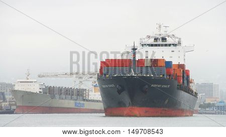 Oakland CA - September 29 2016: Cargo Ship GUENTHER SCHULTE entering the Port of Oakland the fifth busiest port in the United States.