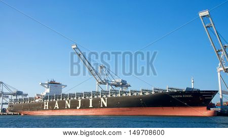 Oakland CA - September 29 2016: All visible cargo unloaded from the vessel Cargo Ship HANJIN JUNGIL awaits assistance to depart from the Port of Oakland. Hanjin Shipping declared bankruptsy on August 31 2016