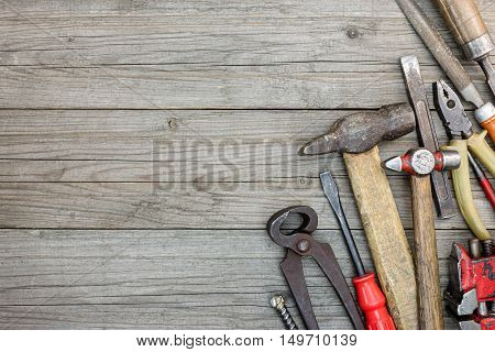 Wooden Grey Boards Background With Various Old Rusty Instruments For Hand Work