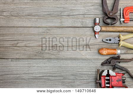 Rusty Hand Tools And Instruments For House Repair And Renovation On Wooden Boards