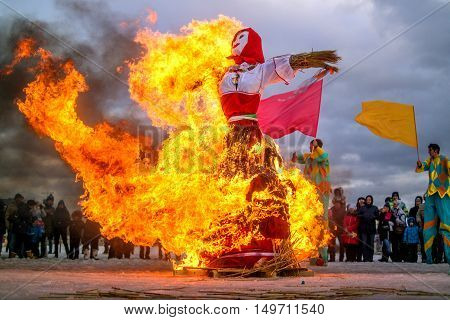Saint-Petersburg Russia - February 22 2015: Feast Maslenitsa on Vasilyevsky Island. Burning doll - a doll almost all burned and there was one skeleton.