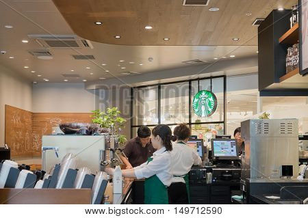OSAKA JAPAN - JUL 11 2016: Starbucks Cafe interior. Starbucks Corporation is an American global coffee company and coffeehouse chain based in Seattle Washington