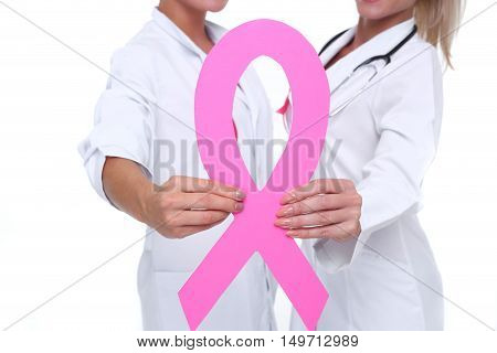 healthcare, charity, support and medicine concept - group of female doctors with pink breast cancer awareness ribbon