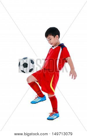 Full length portrait of happy asian soccer player in red uniform bounce his soccer ball studio shot. Isolated on white background.