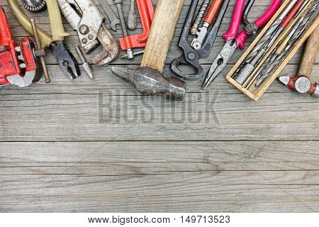 Set Of Different Old Rusty Tools And Instruments For Hand Work And House Repair On Wooden Boards