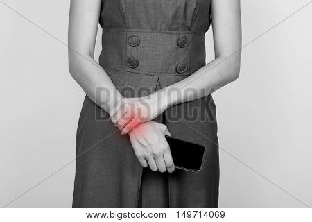 a business woman having a wrist pain